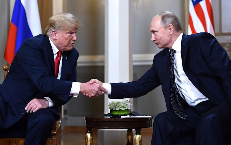 President Donald Trump and President Vladimir Putin meeting in Finland in 2018. | BRENDAN SMIALOWSKI/AFP/Getty Images