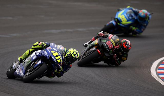 Motorcycle Racing - Argentina Motorcycle Grand Prix - MotoGP race - Termas de Rio Hondo, Argentina - April 8, 2018 - Movistar Yamaha rider Valentino Rossi (46) of Italy, Monster Yamaha Tech 3 rider Hafizh Syahrin of Malaysia (55) and Team Suzuki Ecstar rider Andrea Iannone of Italy compete. REUTERS/Marcos Brindicci