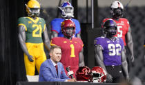 Oklahoma head football coach Lincoln Riley speaks from the stage with mannequins in the back ground during NCAA college football Big 12 media days Wednesday, July 14, 2021, in Arlington, Texas. (AP Photo/LM Otero)