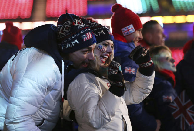 United States athletes pose for photos during the closing ceremony of the 2018 Winter Olympics in Pyeongchang, South Korea, Sunday, Feb. 25, 2018. (AP Photo/Natacha Pisarenko)
