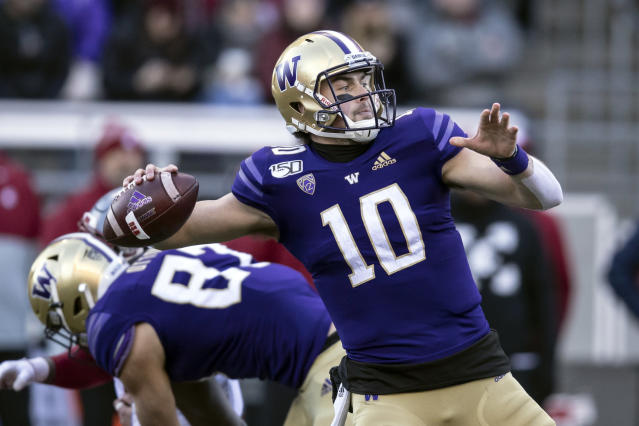 FILE - In this Nov. 29, 2019, file photo, Washington quarterback Jacob Eason throws a pass during the first half of an NCAA college football game against Washington State in Seattle. Ohio. The Indianapolis Colts selected Eason in the fourth round of the NFL football draft on Saturday, April 25, 2020. (AP Photo/Stephen Brashear, File)
