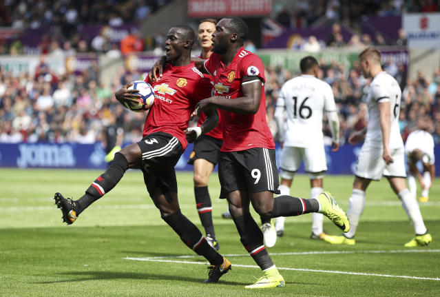 "<a class=""link rapid-noclick-resp"" href=""/soccer/teams/manchester-united/"" data-ylk=""slk:Manchester United"">Manchester United</a>'s Eric Bailly, left, celebrates with teammate Romelu Lukaku after scoring his side's first goal during their English Premier League soccer match at the Liberty Stadium, Swansea, Wales, Saturday, Aug. 19, 2017. (Nick Potts/PA via AP)"