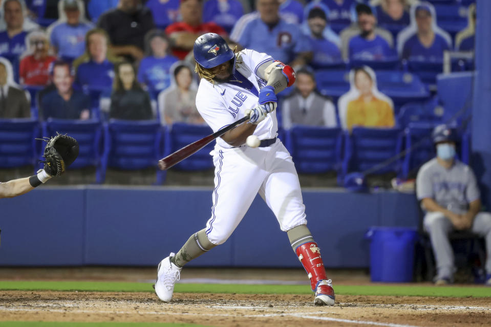 Toronto Blue Jays' Vladimir Guerrero Jr. hits a solo home run against the Philadelphia Phillies during the sixth inning of a baseball game Friday, May 14, 2021, in Dunedin, Fla. (AP Photo/Mike Carlson)