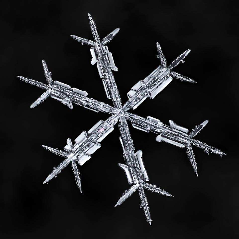 <p>All these snowflakes are photographed on the same homemade black mitten as a background. (Photo: Don Komarechka/Caters News) </p>