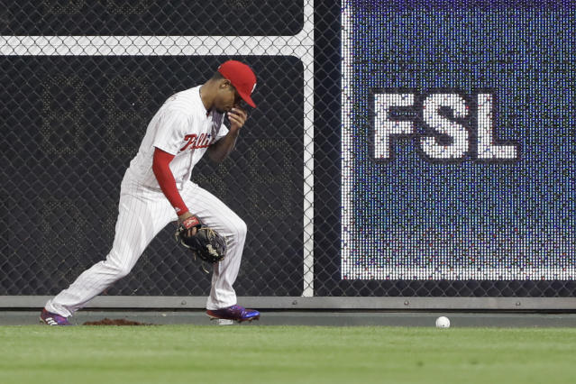 "<a class=""link rapid-noclick-resp"" href=""/mlb/players/9633/"" data-ylk=""slk:Nick Williams"">Nick Williams</a> got hit in the nose after a ball bounced off the wall. (AP Photo)"