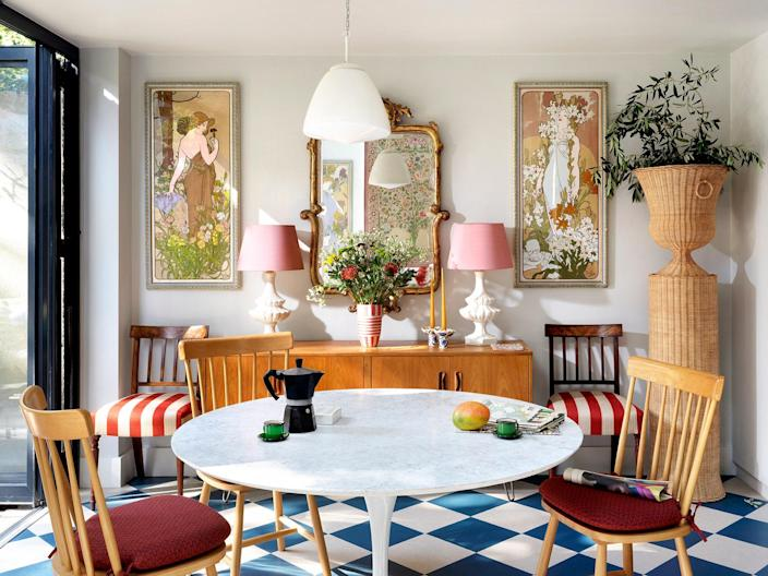 The dining room includes four Art Nouveau pieces that depict each of the seasons. The amazing rattan planter is from Atelier Vime.