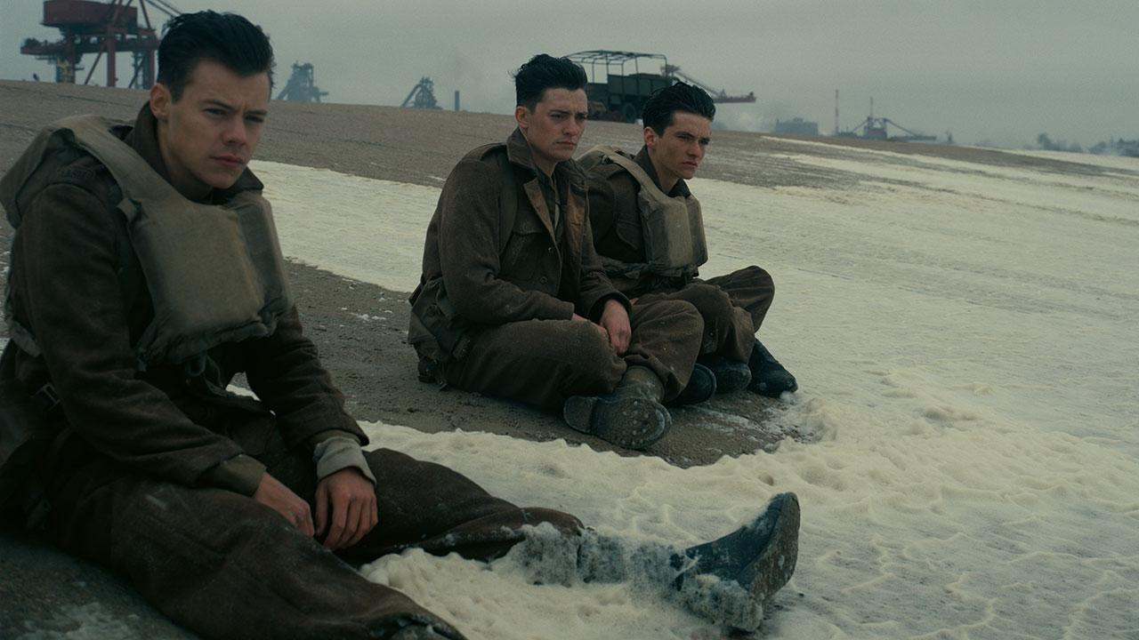 Harry Styles, Aneurin Barnard, and Fionn Whitehead play a trio of stranded soldiers in 'Dunkirk' (WB)