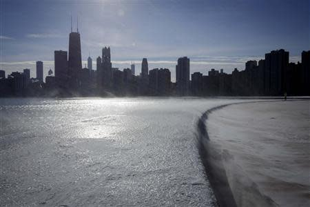 Ice covers the shore of Lake Michigan in Chicago where temperatures have dropped well below freezing, December 12, 2013. REUTERS/John Gress