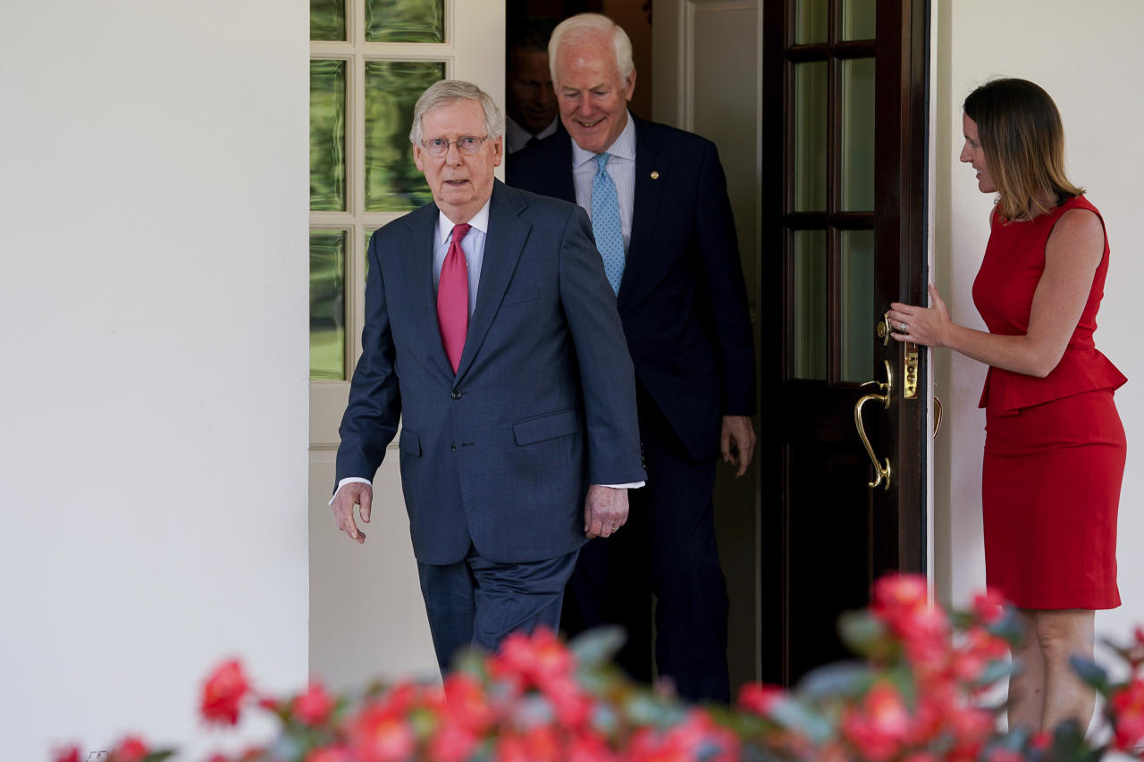 <p> Senate Majority Leader Mitch McConnell of Ky., followed by Senate Majority Whip John Cornyn Texas, leave the White House in Washington, Wednesday, July 19, 2017, to speak to members of the media following a luncheon with President Donald Trump and other GOP leadership. (AP Photo/Andrew Harnik) </p>