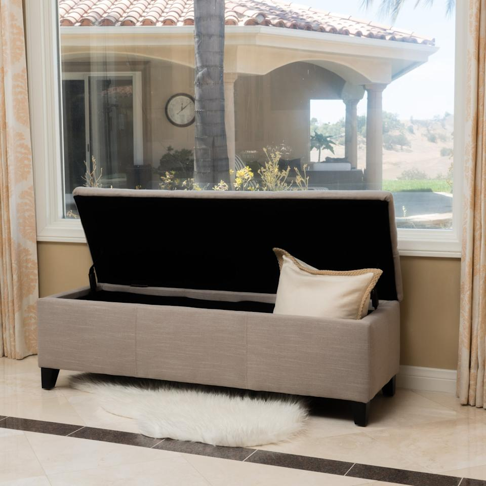 """<p>Store extra blankets and more in this <a href=""""https://www.popsugar.com/buy/Noble-House-James-Storage-Ottoman-489938?p_name=Noble%20House%20James%20Storage%20Ottoman&retailer=walmart.com&pid=489938&price=100&evar1=casa%3Auk&evar9=46607561&evar98=https%3A%2F%2Fwww.popsugar.com%2Fhome%2Fphoto-gallery%2F46607561%2Fimage%2F46608063%2FNoble-House-James-Storage-Ottoman&list1=shopping%2Cwalmart%2Corganization%2Cbedrooms%2Chome%20organization%2Chome%20shopping&prop13=api&pdata=1"""" rel=""""nofollow"""" data-shoppable-link=""""1"""" target=""""_blank"""" class=""""ga-track"""" data-ga-category=""""Related"""" data-ga-label=""""https://www.walmart.com/ip/Noble-House-James-Sand-Fabric-Storage-Ottoman/55611002"""" data-ga-action=""""In-Line Links"""">Noble House James Storage Ottoman</a> ($100).</p>"""