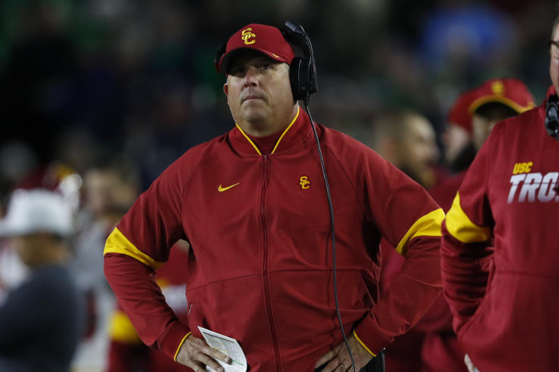 Southern California head coach Clay Helton watches against Notre Dame in the first half of an NCAA college football game in South Bend, Ind., Saturday, Oct. 12, 2019. (AP Photo/Paul Sancya)