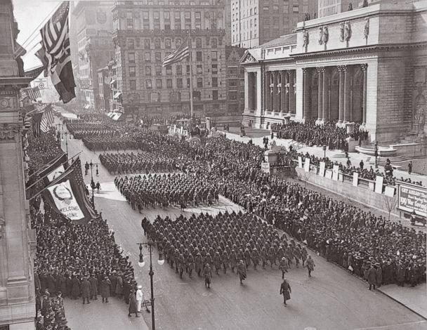 PHOTO: The famous 369th Infantry known as 'Hellfighters' march by crowds standing in front of the New York Public Library on 42nd St. and Fifth Ave.in New York City, in a parade held in honor of their return to the country, on Feb. 18, 1919. (NARA)