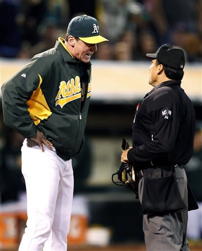 Oakland Athletics manager Bob Melvin, left, argues a call with home plate umpire Phil Cuzzi in the sixth inning against the Boston Red Sox in a baseball game Saturday, Sept. 1, 2012 in Oakland, Calif. (AP Photo/Tony Avelar)