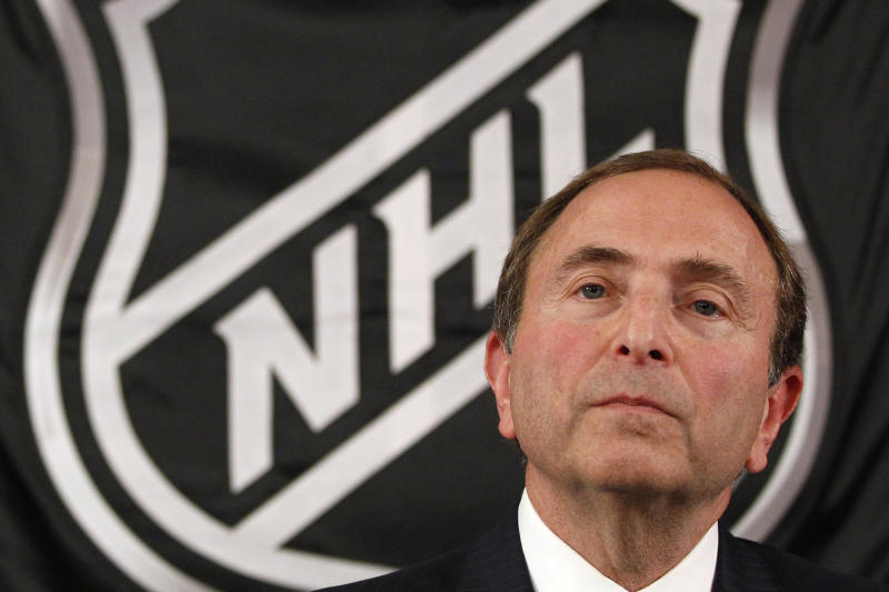 FILE - In this Sept. 13, 2012, file photo, NHL commissioner Gary Bettman listens as he meets with reporters after a meeting with team owners in New York. The National Hockey Leage Players' Association announces its decision whether to terminate the current collective bargaining agreement and set the clock ticking toward another potential work stoppage in 2020. (AP Photo/Mary Altaffer, File)