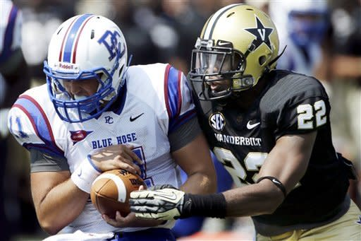 Presbyterian quarterback Tamyn Garrick (11) is sacked by Vanderbilt safety Eric Samuels (22) in the second quarter of an NCAA college football game, Saturday, Sept. 15, 2012, in Nashville, Tenn. (AP Photo/Mark Humphrey)