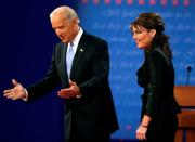 FILE PHOTO: Senator Joe Biden and Alaska Governor Sarah Palin appear onstage during the vice presidential debate in St.Louis
