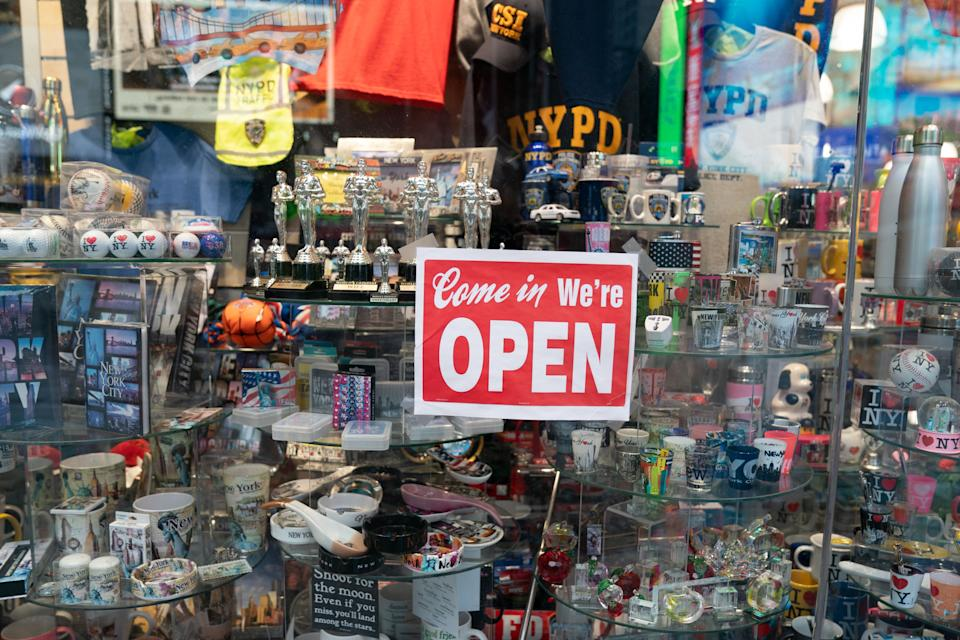 An open sign in the window of a gift shop is seen in Times Square on August 16, 2020 in New York. - Five months after New York City shut down to combat the coronavirus, the tourism industry remains flat. Business leaders and City officials are trying to devise plans to revive the tourism industry that has in years past brought in $45 billion annually and supported 300,000 jobs. (Photo by Bryan R. Smith / AFP) (Photo by BRYAN R. SMITH/AFP via Getty Images)