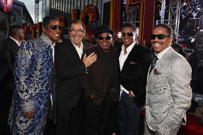 "This Oct. 27, 2009 file photo shows Jermaine Jackson, Director/Producer Kenny Ortega, Tito Jackson, Jackie Jackson and Marlon Jackson at Columbia Pictures' Premiere of Michael Jackson's ""This Is It"" at the Nokia Theatre L.A. Live, in Los Angeles. Jurors hearing a case filed by Katherine Jackson over her son Michael's death have received a behind-the-scenes look at the superstar's troubles off-camera as he prepared for his ill-fated comeback shows. The panel was reminded on Thursday, Aug. 8, 2013, of statements describing the ""Thriller"" singer as deteriorating and slow to pick up material for the shows that would heavily feature the hits that made him famous, but defense attorneys for concert promoter AEG Live LLC say the ""This Is It"" footage is an accurate portrayal of his preparations and doesn't show Jackson in decline. (Photo by Eric Charbonneau/Invision/AP Images, File)"