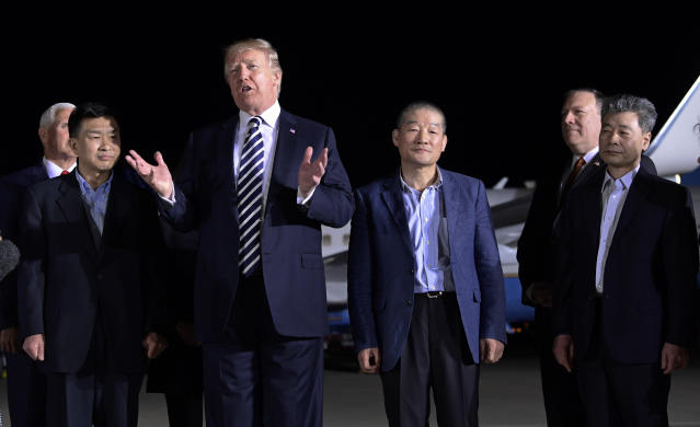 President Trump speaks as he stands with Tony Kim, left, Kim Dong-chul, center right, and Kim Hak-song, right, after they arrived at Andrews Air Force Base early Thursday morning. Vice President Mike Pence, far left, and Secretary of State Mike Pompeo, second from right, look on. (Photo: Susan Walsh/AP)