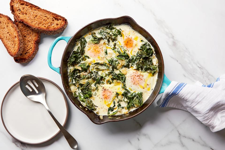 """Epi contributor Christian Reynoso's greens-and-eggs recipe is just the kind of thing you can get at a fancy restaurant, but you can absolutely make it at home. <a href=""""https://www.epicurious.com/recipes/food/views/peppery-creamy-greens-with-eggs-brunch?mbid=synd_yahoo_rss"""" rel=""""nofollow noopener"""" target=""""_blank"""" data-ylk=""""slk:See recipe."""" class=""""link rapid-noclick-resp"""">See recipe.</a>"""