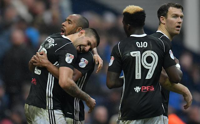 "Soccer Football - Championship - Preston North End vs Fulham - Deepdale, Preston, Britain - March 10, 2018 Fulham's Aleksandar Mitrovic celebrates with team mates after scoring their second goal Action Images/Paul Burrows EDITORIAL USE ONLY. No use with unauthorized audio, video, data, fixture lists, club/league logos or ""live"" services. Online in-match use limited to 75 images, no video emulation. No use in betting, games or single club/league/player publications. Please contact your account representative for further details."