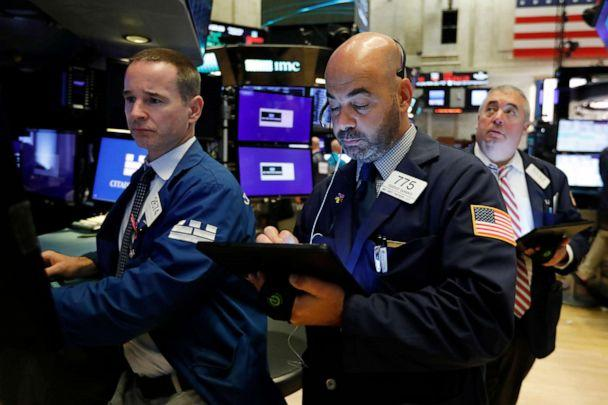 PHOTO: Specialist Stephen Naughton, left, works with trader Fred DeMarco on the floor of the New York Stock Exchange, Aug. 21, 2019. (Richard Drew/AP)