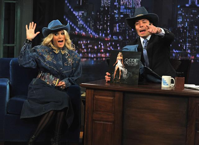 """NEW YORK, NY - NOVEMBER 08: Carrie Underwood and Jimmy Fallon perform a skit during a taping of """"Late Night With Jimmy Fallon"""" at Rockefeller Center on November 8, 2012 in New York City. (Photo by Theo Wargo/Getty Images)"""