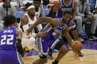 Sacramento Kings forward Harrison Barnes, right, and Portland Trail Blazers forward Robert Covington, second from left, chase after the ball during the first quarter of an NBA basketball game in Sacramento, Calif., Wednesday, Jan. 13, 2021. (AP Photo/Rich Pedroncelli)