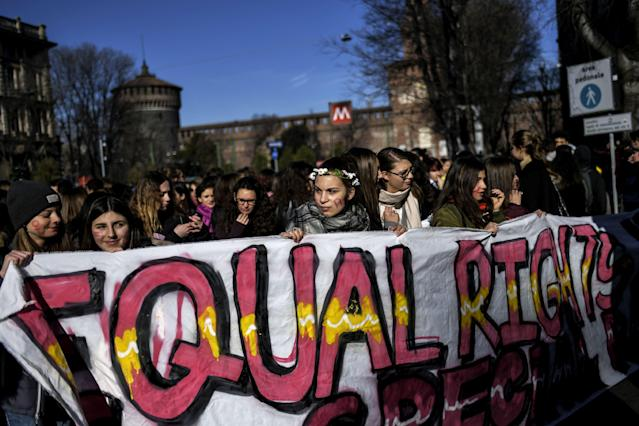 <p>Young women take part in the Women's March against Violence as part of International Women's Day on March 8, 2018, in Milan, Italy. (Photo: Marco Bertorello/AFP/Getty Images) </p>