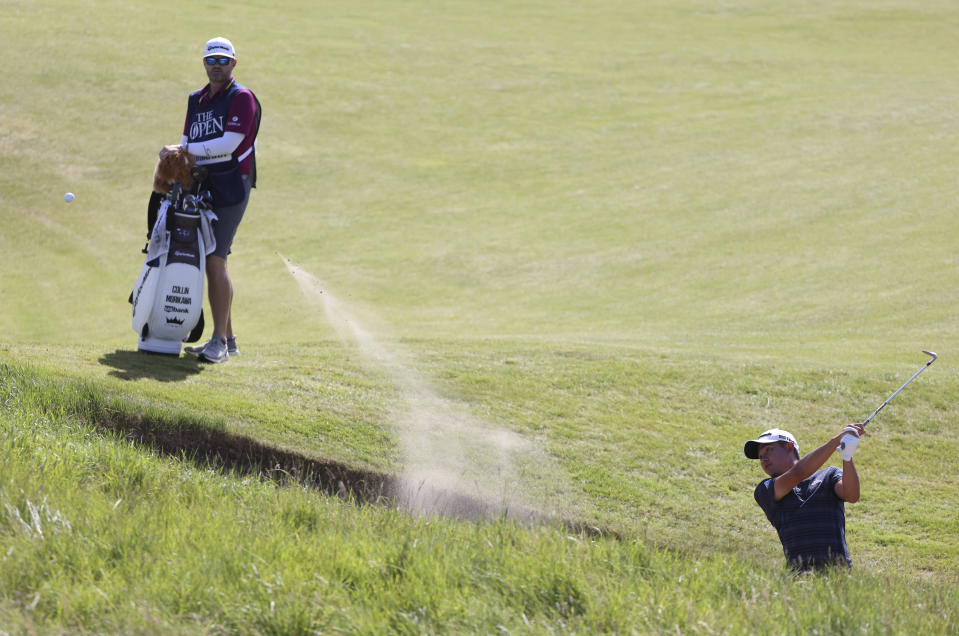 United States' Collin Morikawa play out of a bunker on the 2nd hole during the third round of the British Open Golf Championship at Royal St George's golf course Sandwich, England, Saturday, July 17, 2021. (AP Photo/Ian Walton)