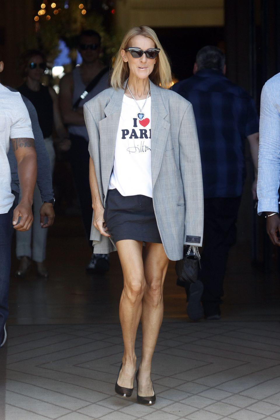 """<p>For this cheeky look, Dion paired an """"I Love Paris Hilton"""" tee with a miniskirt, oversized blazer, and simple pumps. And if you look closely, you'll see that she's wearing the Heart of the Ocean necklace from <em>Titanic. </em>I-con-ic.</p>"""