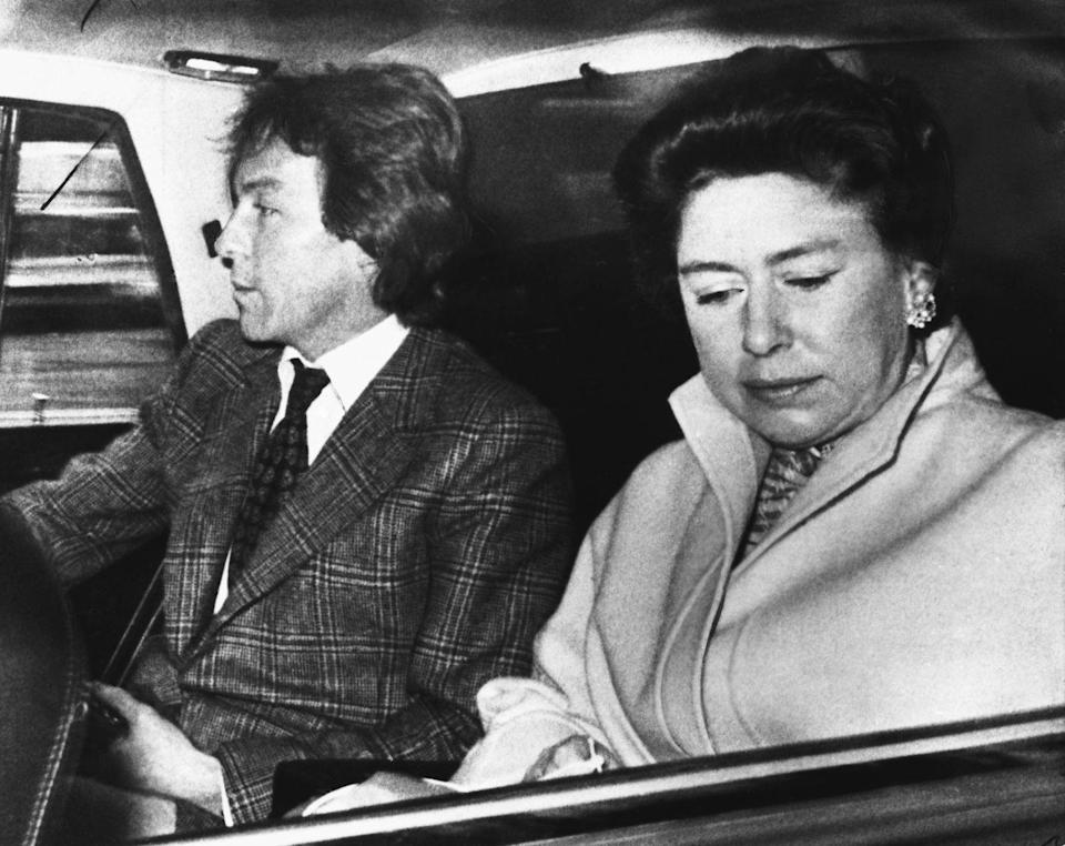 <p>Princess Margaret and her boyfriend Roddy Llewellyn on their way to the airport before departing to the Caribbean. The two were later caught in a very public affair. </p>