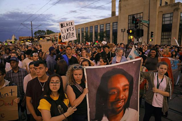 <p>Supporters of Philando Castile hold a portrait of Castile as they march along University Avenue in St. Paul, Minn., leaving a vigil at the state Capitol on Friday, June 16, 2017. The vigil was held after St. Anthony police Officer Jeronimo Yanez was cleared of all charges in the fatal shooting last year of Castile. (Anthony Souffle/Star Tribune via AP) </p>