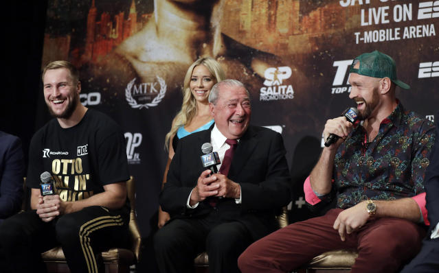 Otto Wallin, of Sweden, left, promoter Bob Arum and Tyson Fury, right, laugh during a news conference Wednesday, Sept. 11, 2019, in Las Vegas. Wallin and Fury will face each other in a heavyweight boxing match Saturday. (AP Photo/Isaac Brekken)