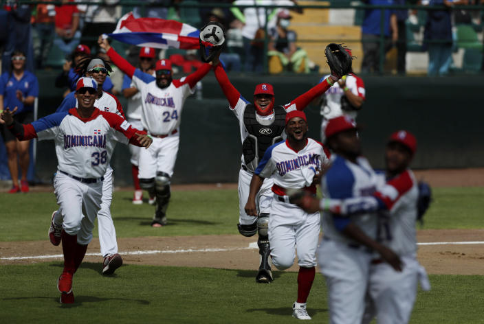 Dominican Republic players celebrate after their 8-5 victory over Venezuela in a final Olympic baseball qualifier game, in Puebla, Mexico, Saturday, June 26, 2021. (AP Photo/Fernando Llano)