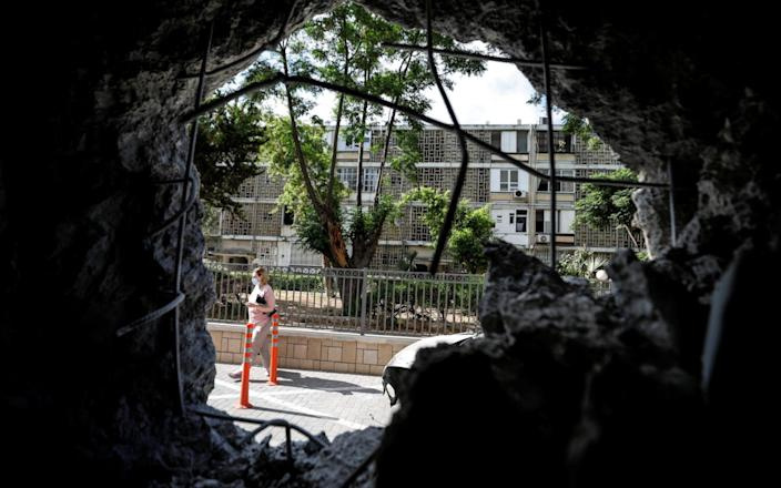 A residential building in Ashkelon that was damaged by a rocket launched overnight from the Gaza Strip - AMIR COHEN/REUTERS