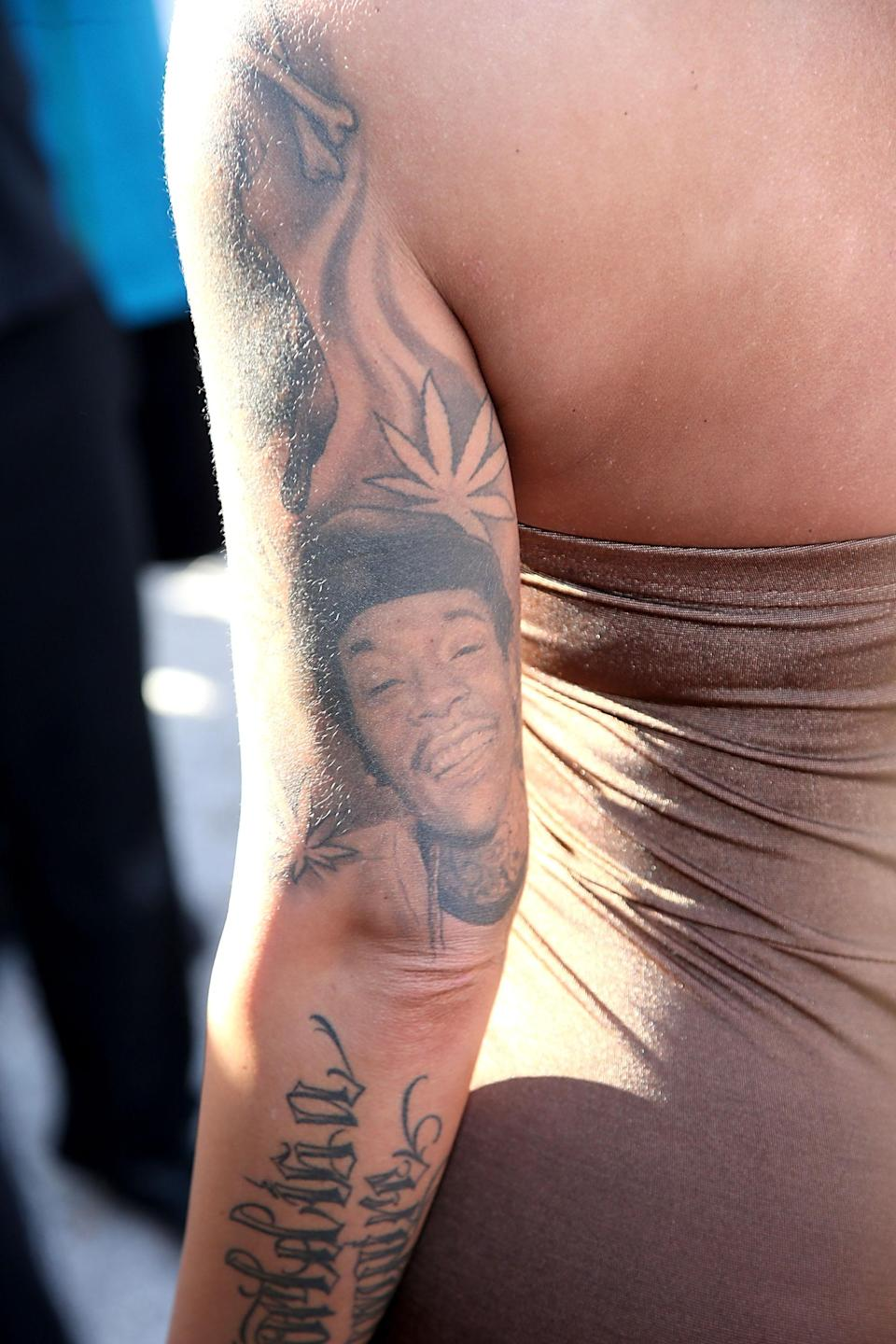 Amber Rose had Wiz Khalifa's face on her arm once upon a time. She's had it covered up post breakup. (Photo: Getty Images)