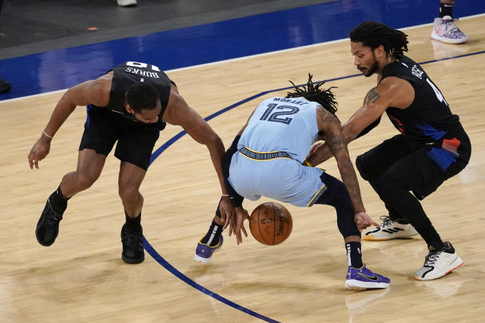 New York Knicks guard Alec Burks (18) and guard Derrick Rose (4) compete for the ball against Memphis Grizzlies guard Ja Morant (12) during the first half of an NBA basketball game Friday, April 9, 2021, at Madison Square Garden in New York. (AP Photo/Mary Altaffer, Pool)