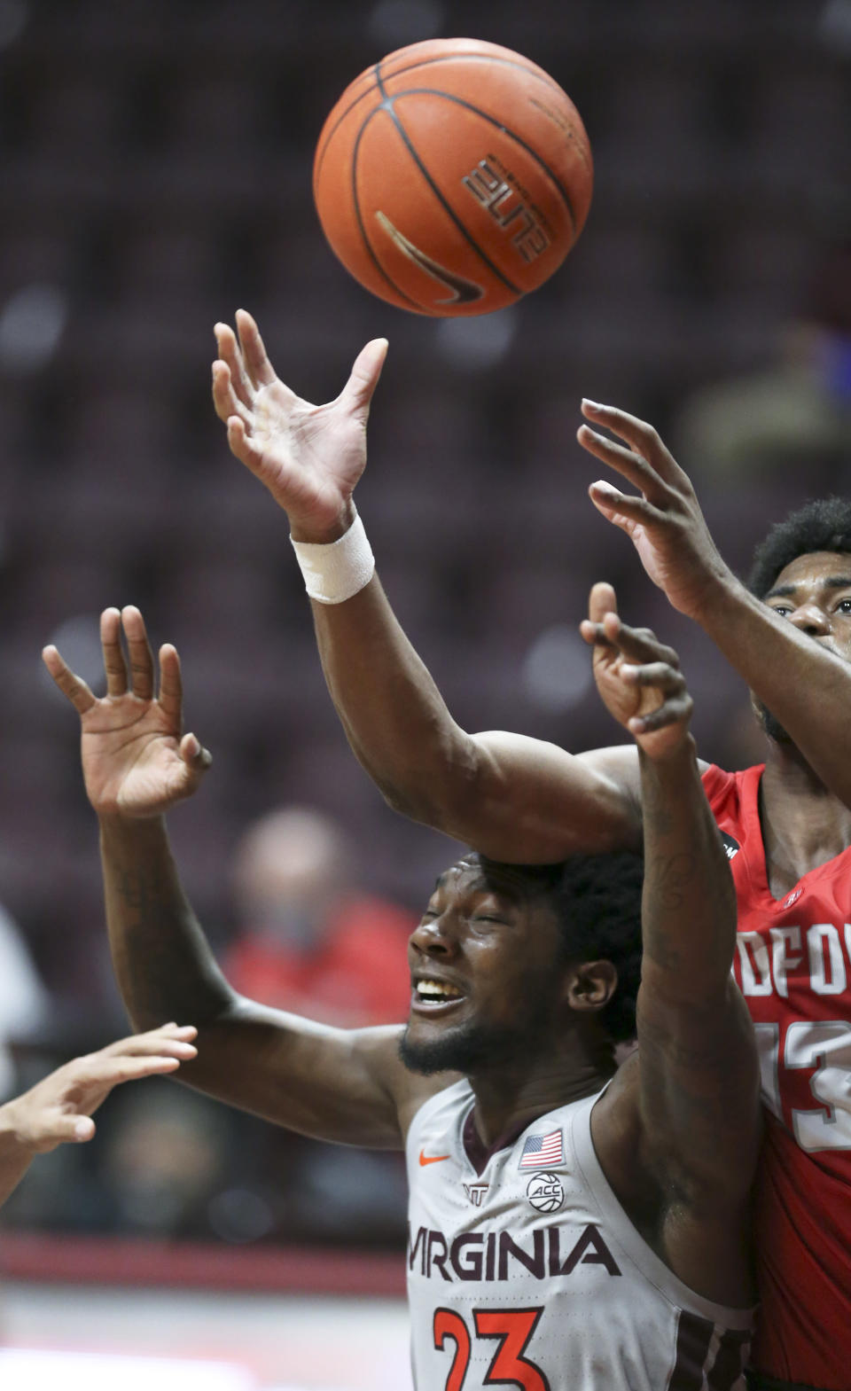 Virginia Tech's Tyrece Radford (22) and Radford Shaquan Jules (13) reach for a rebound in the second half of an NCAA college basketball game, Wednesday Nov. 25, 2020, in Blacksburg Va. (Matt Gentry/The Roanoke Times via AP)