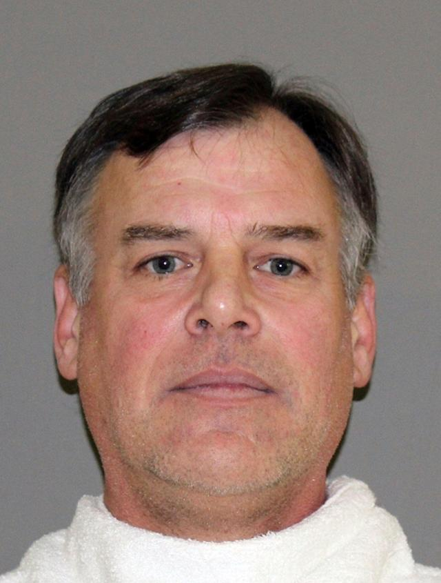 """Former MLB pitcher John Wetteland is """"completely shocked"""" by the allegations against him, his attorney says. (Denton County Jail via AP, File)"""