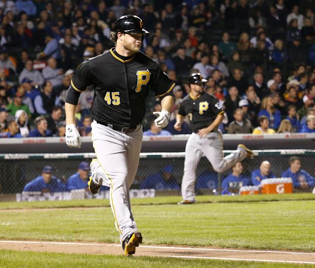Pittsburgh Pirates' Gerrit Cole heads to first after hitting a two-run single off Chicago Cubs starting pitcher Chris Rusin, scoring Gaby Sanchez and Pedro Alvarez, during the second inning of a baseball game Tuesday, Sept. 24, 2013, in Chicago. (AP Photo/Charles Rex Arbogast)