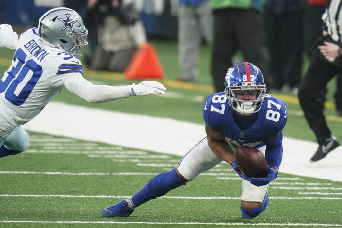 New York Giants' Sterling Shepard, right, makes a catch during the second half of an NFL football game against the Dallas Cowboys, Sunday, Jan. 3, 2021, in East Rutherford, N.J. (AP Photo/Frank Franklin II)