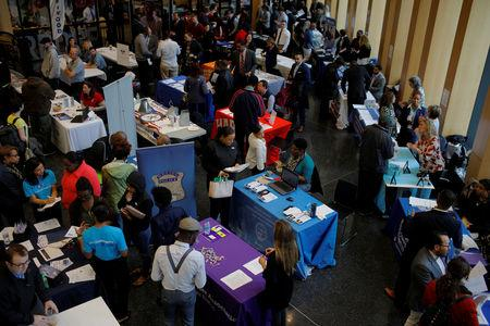 Job seekers speak with potential employers at a City of Boston Neighborhood Career Fair on May Day in Boston