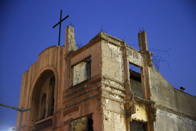In this Nov. 13, 2018, photo, bullet holes from Lebanon's 1975-1990 civil war are seen on the walls of the St. Vincent de Paul church in downtown Beirut, Lebanon. Nearly 30 years after civil war guns fell silent, dozens of bullet-scarred, shell-pocked buildings are still standing _ testimony to a brutal conflict that raged for 15 years and took the lives of 150,000 people.(AP Photo/Hassan Ammar)