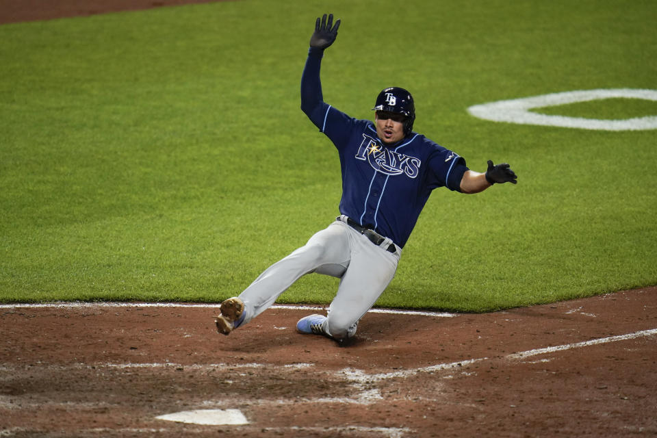 Tampa Bay Rays' Willy Adames slides into home while scoring on a single by Ji-Man Choi during the eighth inning of a baseball game against the Baltimore Orioles, Wednesday, May 19, 2021, in Baltimore. The Rays won 9-7. (AP Photo/Julio Cortez)