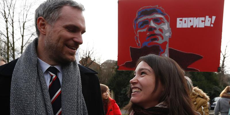 Prague's mayor Zdenek Hrib and Zhanna Nemtsova, the daughter of Russian opposition figure Boris Nemtsov smile after unveiling a sign renaming the square where the Russian embassy is located in Prague on February 27.
