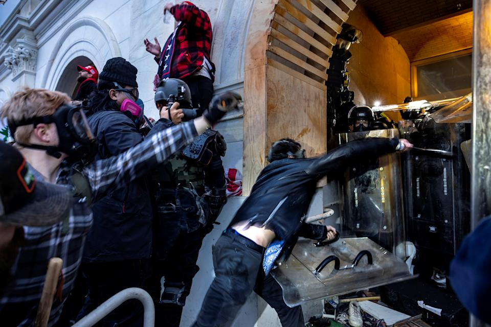 Trump supporters clash with police and security forces as people try to storm the US Capitol on January 6, 2021 in Washington, DC. (Brent Stirton/Getty Images)
