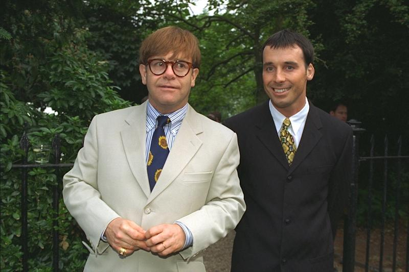 Couple Sir Elton John and David Furnish in suits and ties at celebrity society party in Chelsea (Photo by Tim Graham/Sygma/Corbis via Getty Images)