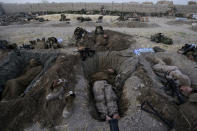 U.S. Marines from the 2nd MEB, 1st Battalion 5th Marines sleep in their fighting holes inside a compound where they stayed for the night, in the Nawa district of Afghanistan's Helmand province, on July 8, 2009. (AP Photo/David Guttenfelder, File)