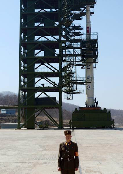 A North Korean guard stands in front of the Unha-3 rocket at the Sohae Satellite Launch Station in Tongchang-Ri on April 8, 2012 (AFP Photo/Pedro Ugarte)